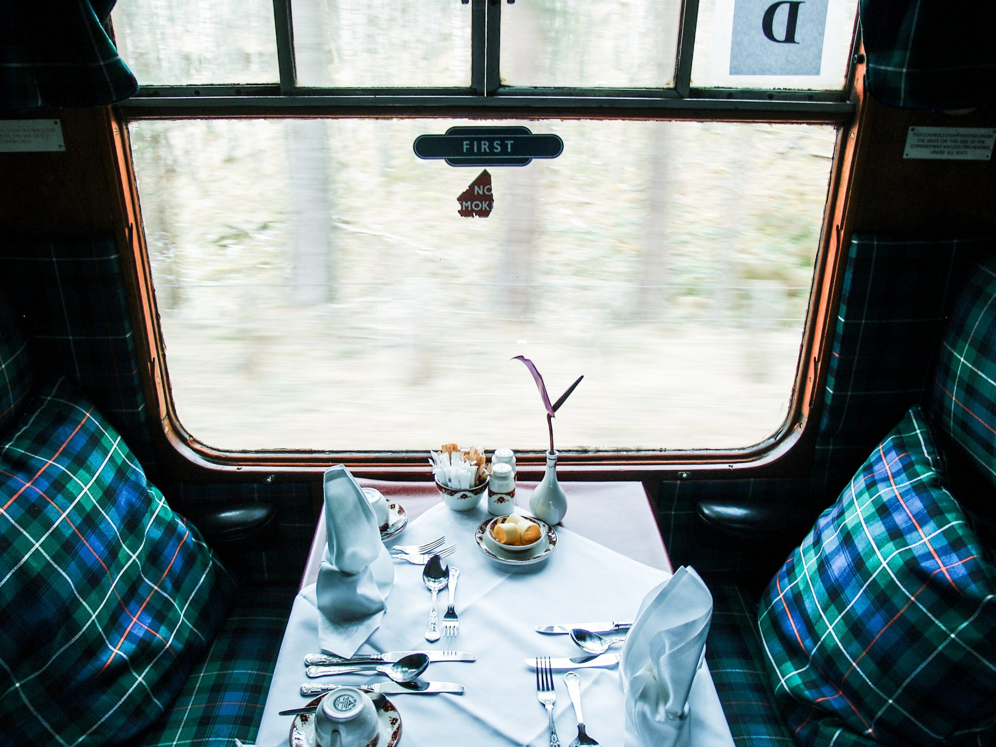 Picture of a dining car in a train with place setting